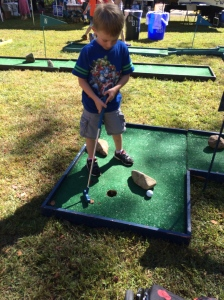 Playing a game of mini golf is a great family bonding experience plus it helps build gross and fine motor skills!