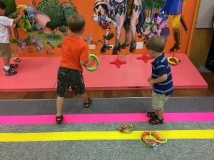 The boys had fun playing ring toss! Little did they know they were enhancing important developmental skills!
