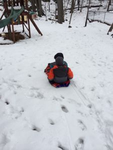 My boys love sledding right in there own backyard!